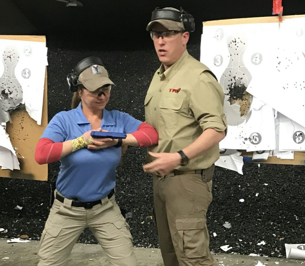 Instructor and student in gun safety training course